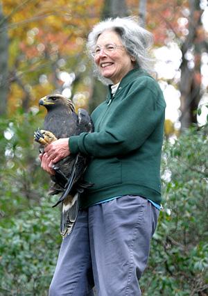 Marcia Bonta holding a golden eagle