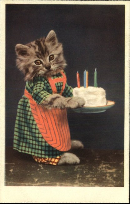 Victorian-era card showing a kitten in apron carrying a birthday cake