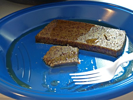 half-eaten slice of scrapple on a plate