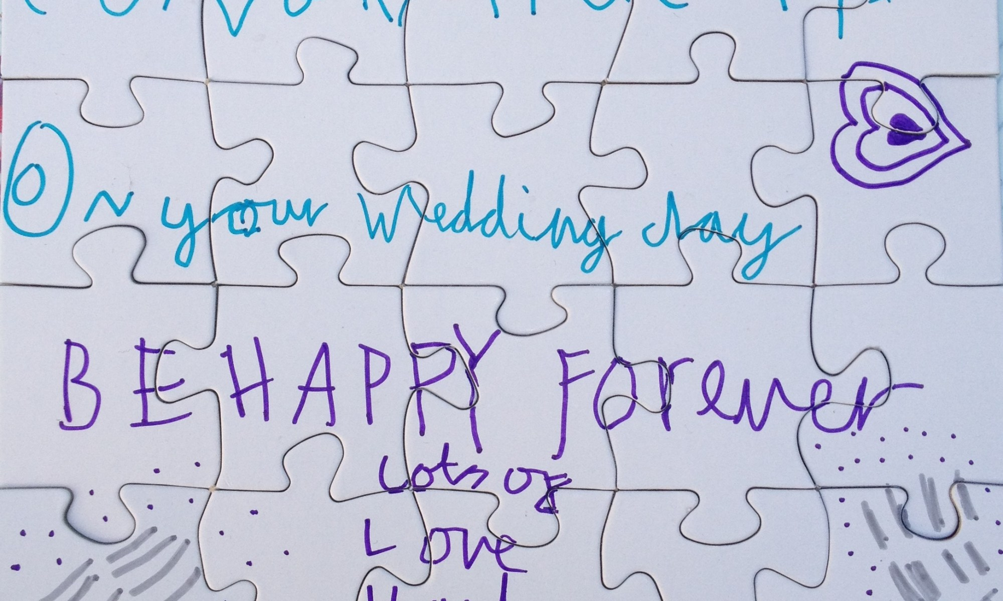 "homemade puzzle by a child: ""CONGRATULATIONS on your Wedding day BE HAPPY forever lots of LOVE Hanley"""