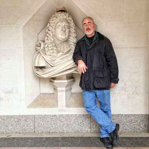 Dave leaning against a bust of Samuel Pepys