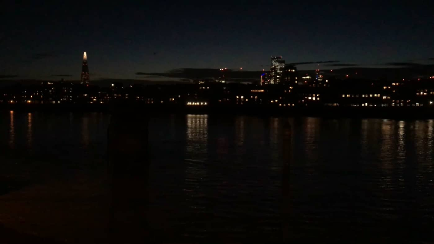 "still from ""summer dusk"" - lights reflected on the river"