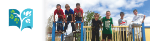 Vianney Logo - Vianney students playing on a playground.