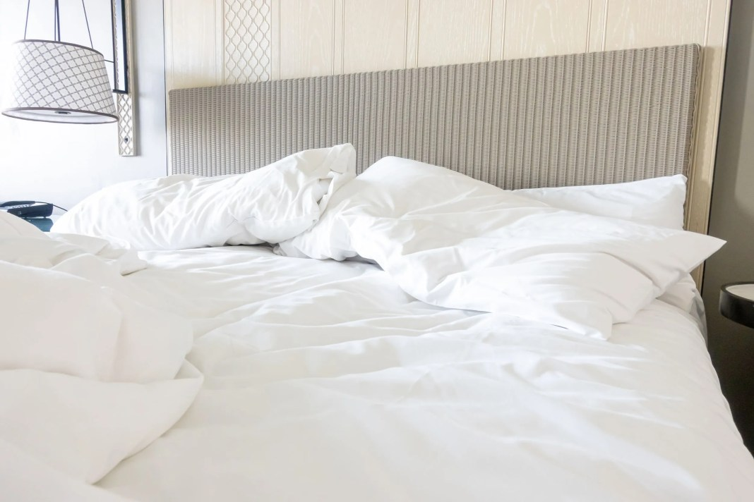 White pillow with lightweight comforter