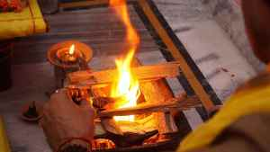 a man performing hawan to start his fast