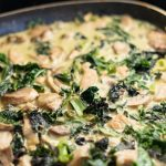 Pork green curry simmering in sauce