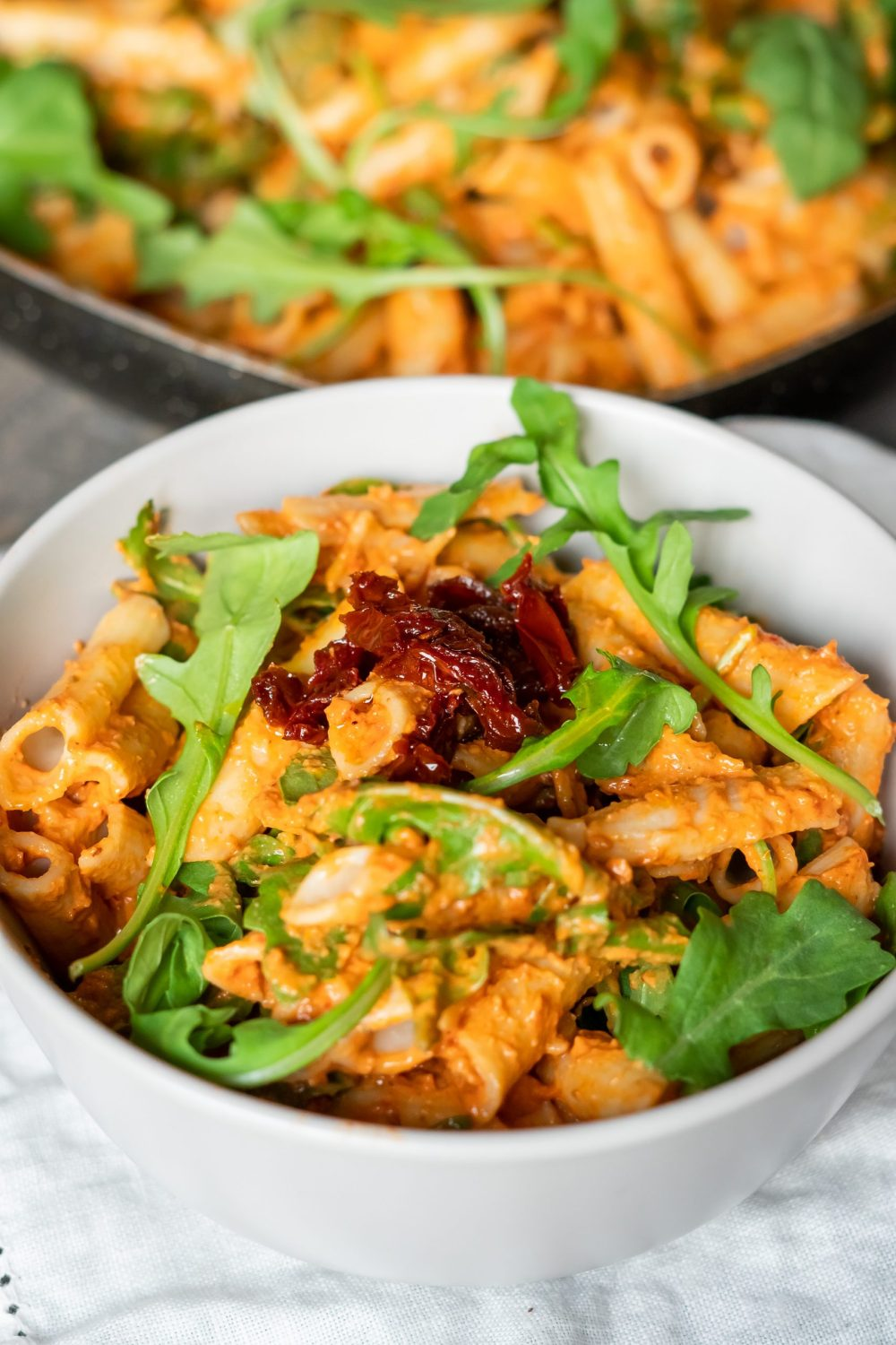 Creamy sun-dried tomato pasta in a bowl