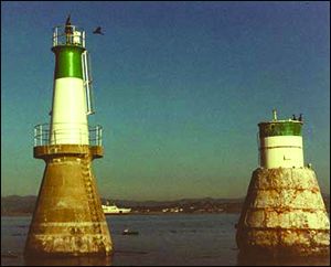 The original aid to navigation was constructed in 1898 lasted ninety-one years. Wave action undermined its base and a new beacon replaced it in 1989.