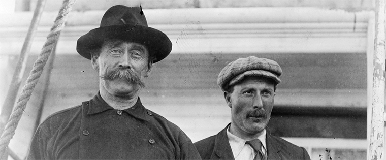 Captain Robert Bartlett and Robert Peary, standing on ship, Battle Harbour, Labrador in 1909. Wikimedia Commons
