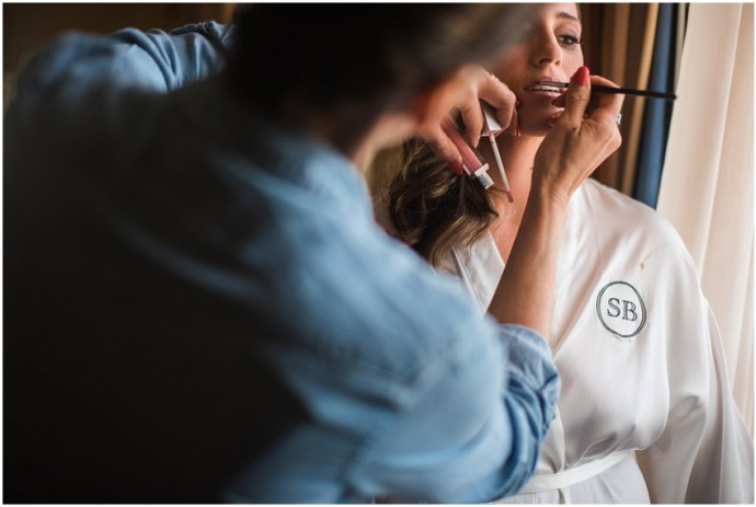 Bride getting her make up done before her wedding at the Biltmore in LA