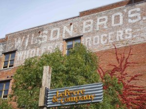 Early 20th century sign for Wilson Brothers Wholesale Grocers on the side of the Wilson Building, 532-538 Herald Street