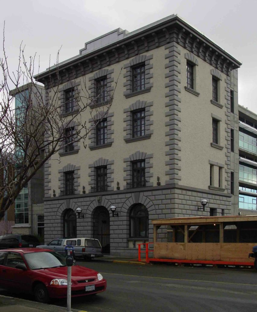 The former Victoria Police headquarters building, 625 Fisgard Street, in 2004 before its facade was incorporated into the C.R.D. building in Centennial Square. (photo by Victoria Online Sightseeing Tours)