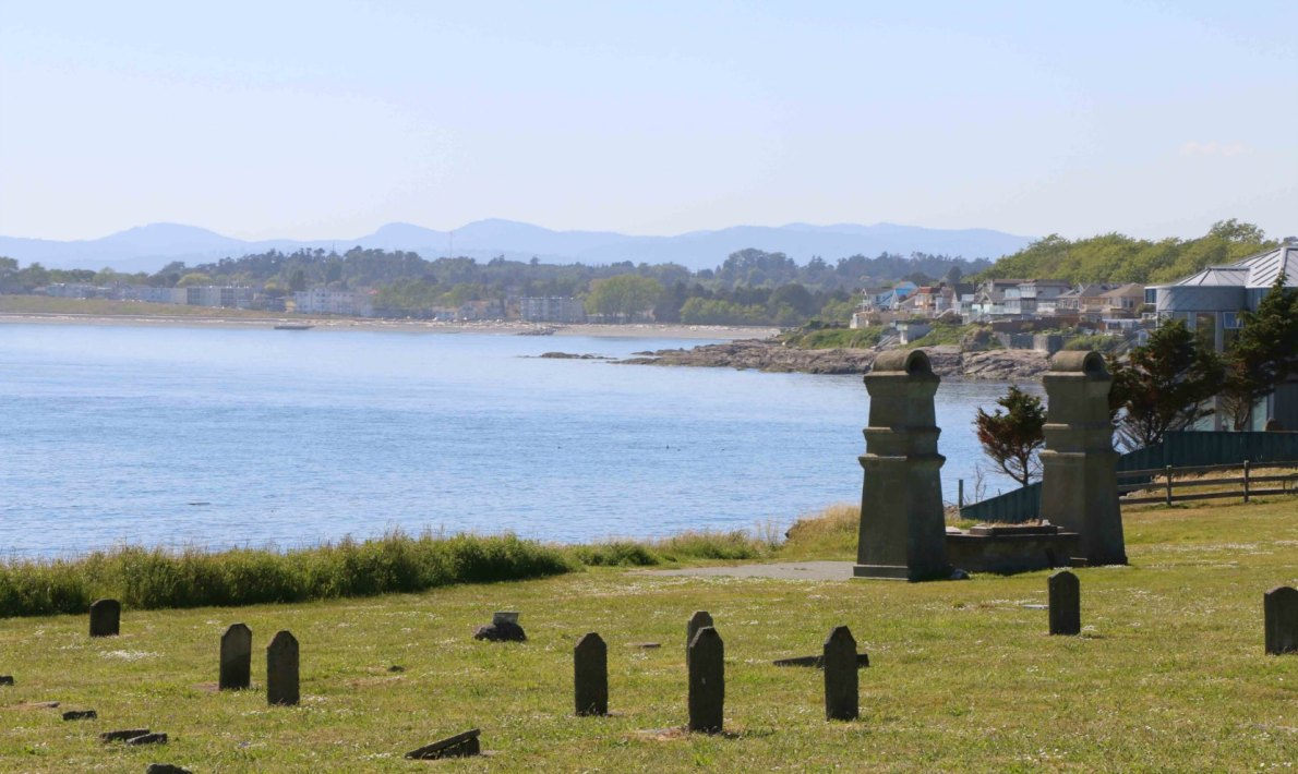 Graves around the altar in the Chinese Cemetery, with Ross Bay in the background