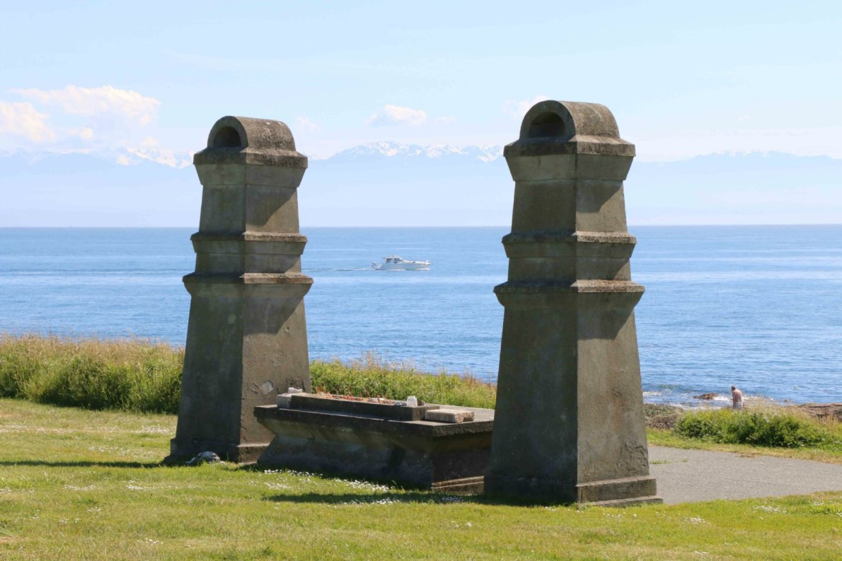 The altar in the Chinese Cemetery with the Olympic Mountains in the background.
