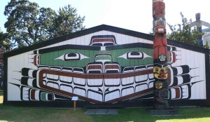 Wawadit'la, also known as Mungo Martin House, was built on this site in 1953. The Kwakwaka'walw Heraldic Pole in front of the building was also carved in 1953.