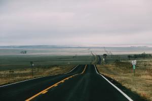 gray asphalt road under gray sky