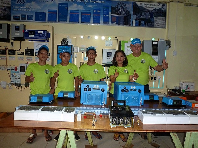 JK Solar Power House team pose with the Victron Energy system components.