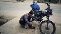 Videonauts backpacking Vietnam Honda Win mechanic
