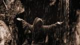 Woman Worshiping In The Rain