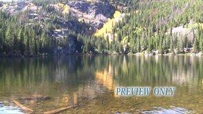 Calm Mountain Lake During Fall Season