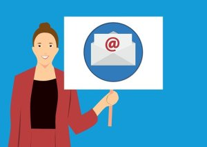 Icon of a woman holding a placard email marketing