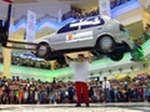 Guy Balances Car On Head