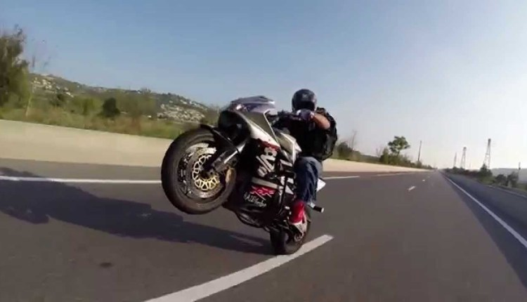 Ridicolous Backwards Wheelie On Highway
