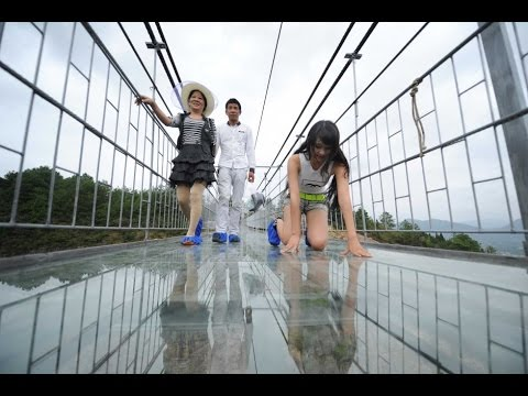 China Opens 600-Feet-High Scary Glass Bridge