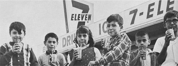 Children drinking fountain drinks outside of a 7Eleven store