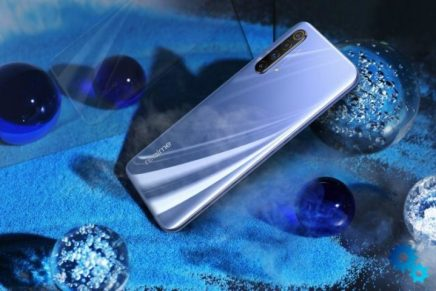 phone placed between blue marbles- Best upcoming phones under 30,000