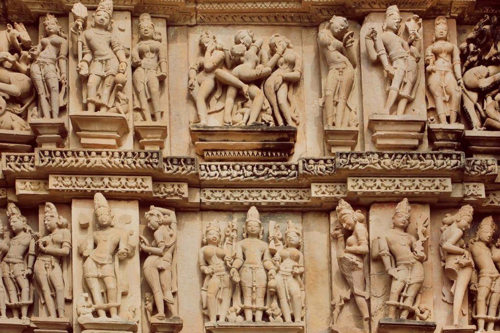 Love Scene In Stone Relief Of Ancient India. Khajuraho Temple Wi