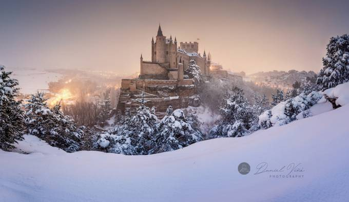 Segovia and Alcazar castle on snow covered landscape. by Danielvg - The Wonders of the World Photo Contest