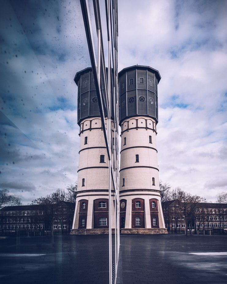 Watertower reflection by bielefoto - My Best New Shot Photo Contest