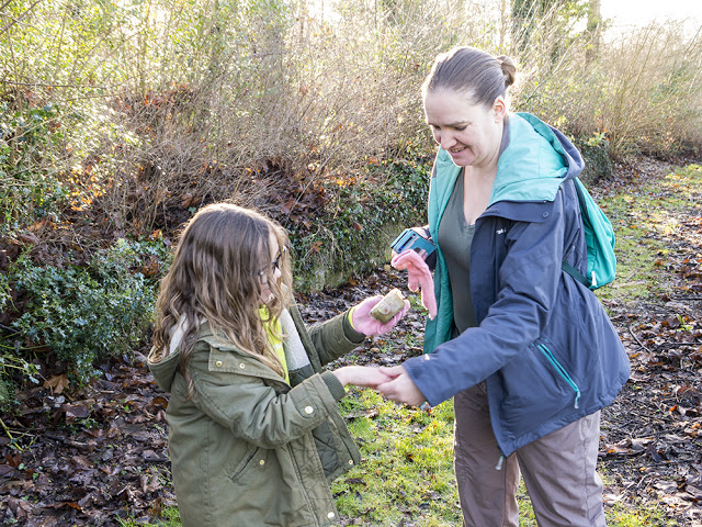 10 Things to take Geocaching - girl and mum finding a cache