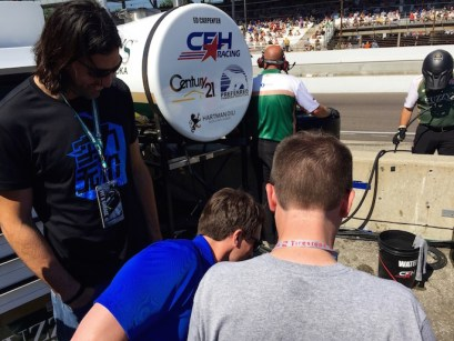 Luis Scola (left), Ryan Carr (right) hang out in Ed Carpenter's pit during Carb Day.