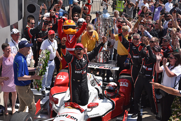 Juan Pablo Montoya celebrates his second Indianapolis 500 win in Victory Lane. (John Cote/IMS)