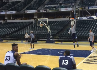 PG and Turner watching their teammates complete the '82 in 2' layup drill.