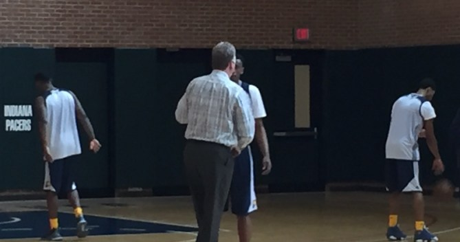 Pacers President Larry Bird shakes Troy Williams' hand after the workout.