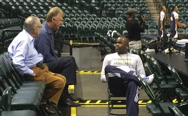 Coach Nate McMillan talks with Donnie Walsh and Larry Bird after a recent practice.