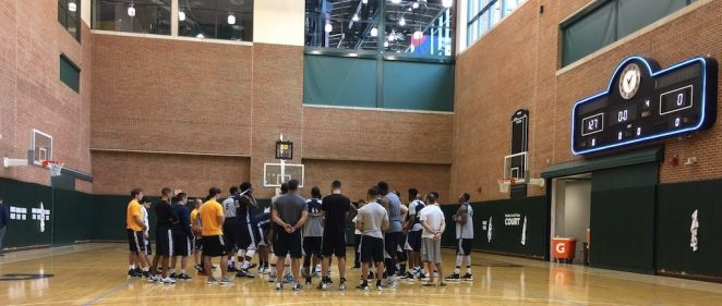Pacers huddle up after a practice session.