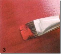 Pinte a moldura do encosto com vermelho