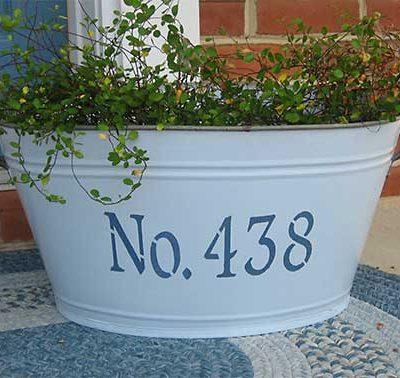 Números novos para a casa numa tina