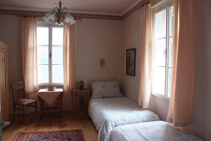 Innenansicht Schlafzimmer Einzelbetten