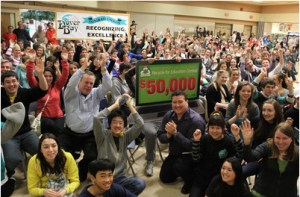 Members of the Dover Bay Eco Club, along with Staples Canada store manager Don MacKinnon (left, blue shirt), District manager Carlo Pellegrino (kneeling, striped shirt) and 250 other Dover Bay science students. Photo: Staples Canada