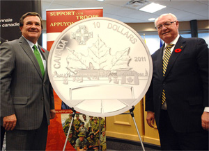 The Honourable Jim Flaherty, Minister of Finance and Minister responsible for the Royal Canadian Mint and Mr. James B. Love, Chair of the Royal Canadian Mint Board of Directors unveil the Mint's Highway of Heroes silver commemorative coin (Photo: Royal CDN Mint)