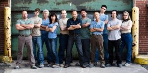 Host Daniel Fathers (centre) puts 10 self-proclaimed know-it-alls to the ultimate test in Canada's Greatest Know-It-All, premiering Jan. 30 on Discovery Channel