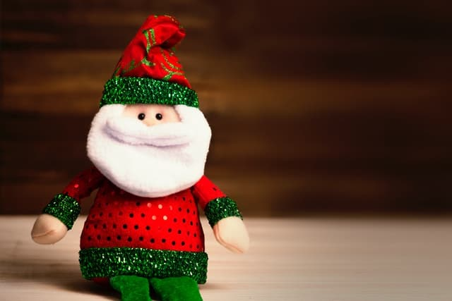 Photo of a plush santa claus toy.