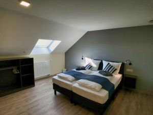 large bedroom with ensuite also accessible for people with disabilities