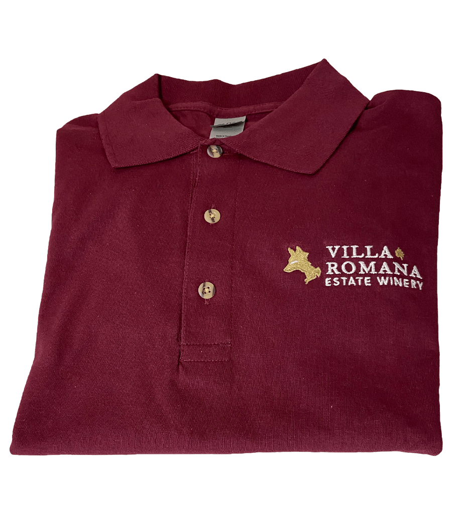 A maroon-coloured red jersey knit cotton polo shirt, with 3 wood tone buttons and a collar, embroidered with the Villa Romana Estate Winery logo and wordmark