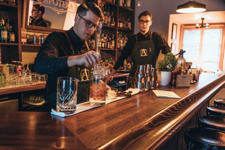 Bartenders working at Apoteka bar in Vilnius